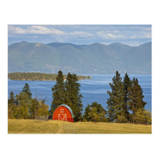 Red barn sits along scenic Flathead Lake near Postcard