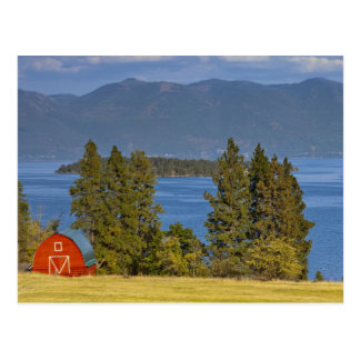 Red barn sits along scenic Flathead Lake near Postcards