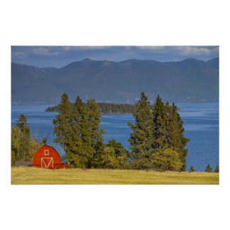 Red barn sits along scenic Flathead Lake near Poster