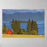 Red barn sits along scenic Flathead Lake near Posters