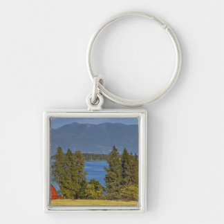 Red barn sits along scenic Flathead Lake near Silver-Colored Square Keychain
