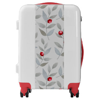 Red Berries on Gray and White Luggage
