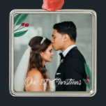 """Red Berries - Our First Christmas - Wedding Photo Metal Ornament<br><div class=""""desc"""">Romantic Christmas ornament celebrating the newly wed's first Christmas as a married couple. Add your own wedding photo. The ornament is decorated with illustrations of leaves and berries in green and red. Our 1st Christmas is written in a modern calligraphy script.</div>"""