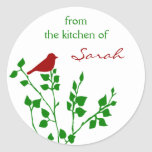 """Red Bird Custom Name Christmas Canning Stickers<br><div class=""""desc"""">These cute and trendy personalized Christmas canning stickers have a red bird sitting in green branches on a white background. Customize the name for a personal touch on canned and baked goods.</div>"""