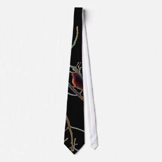 Red bird in branches on black neck tie