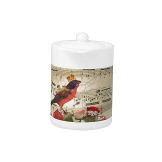 Red bird,  & roses  on vintage music sheet teapot