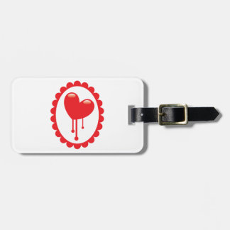 Red bleeding heart on a cameo bag tag