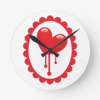 Red bleeding heart on a cameo round clock