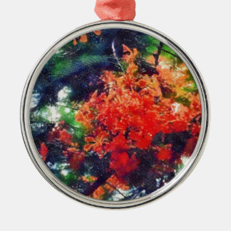 Red blooms on a tree metal ornament