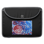 Red, Blue and Pale Gray Swirl Pattern. On Black. Sleeves For MacBook Pro