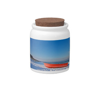 Red boat on shore of the Baltic sea in winter Candy Jar