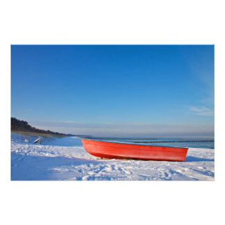 Red boat on shore of the Baltic Sea in winter Photo Print