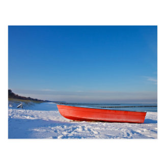 Red boat on shore of the Baltic sea in winter Postcard