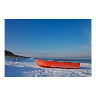 Red boat on shore of the Baltic Sea in winter Poster