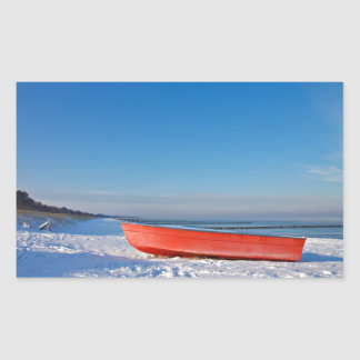 Red boat on shore of the Baltic sea in winter Rectangular Sticker