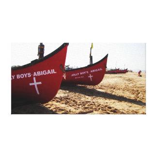 Red Boats on Candolim Beach Goa India Canvas Print