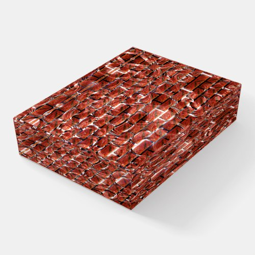 Red brick effect over drawing of metallic circles  paperweight