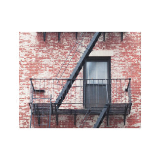 red brick facade with fire escape canvas print