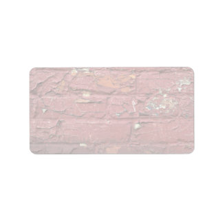 Red brick wall, chipped paint address label