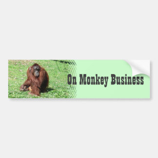 Red-Brown Haired Orangutan Sitting On Grass Bumper Sticker