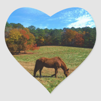 Red Brown horse, fall trees, blue skies Heart Sticker