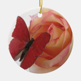 red butterfly on pink rose round ornament