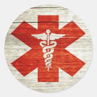 Red caduceus medical symbol classic round sticker