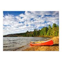 Red canoe on lake shore invitation