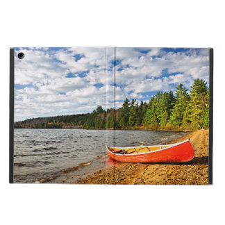 Red canoe on lake shore case for iPad air