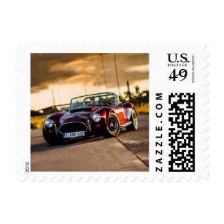 Red car.Classic car Stamp