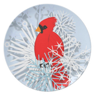 Red cardinal in snow stars dinner plate