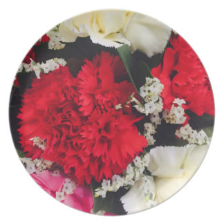 red carnations baby breath picnic fun dinner plate