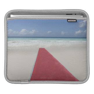 Red carpet on a beach sleeve for iPads