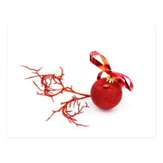 Red christmas ball with twig on white background postcard