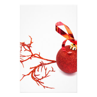 Red christmas ball with twig on white background stationery