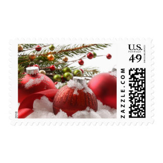 Red christmas balls in the snow postage