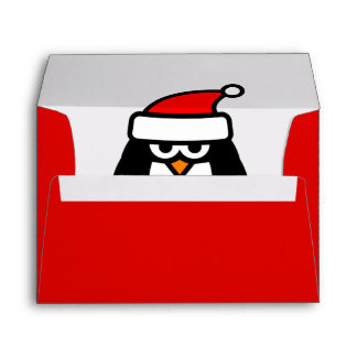 Red Christmas envelopes with funny Santa penguin