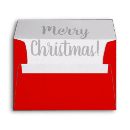 Red Christmas envelopes with handlettered liner