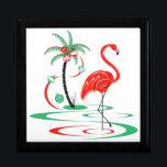 """Red Christmas Flamingo gift box<br><div class=""""desc"""">A fun, festive, flamingo design with a retro touch in red and green. A red flamingo wades in the water next to a palm tree decorated with Christmas baubles and ribbon. A customizable design for you to personalise with your own text, images and ideas. An original digital art image created...</div>"""