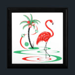"Red Christmas Flamingo gift box<br><div class=""desc"">A fun, festive, flamingo design with a retro touch in red and green. A red flamingo wades in the water next to a palm tree decorated with Christmas baubles and ribbon. A customizable design for you to personalise with your own text, images and ideas. An original digital art image created...</div>"