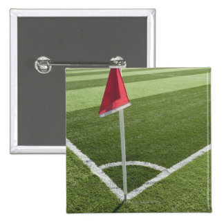 Red corner flag on soccer field button