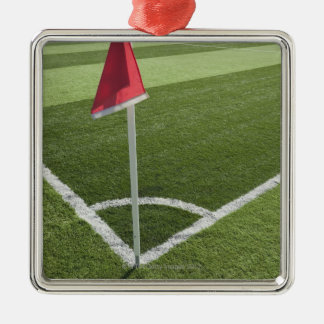 Red corner flag on soccer field square metal christmas ornament