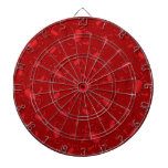 Red crab pattern dartboard with darts