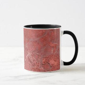 red cracked plaster mug