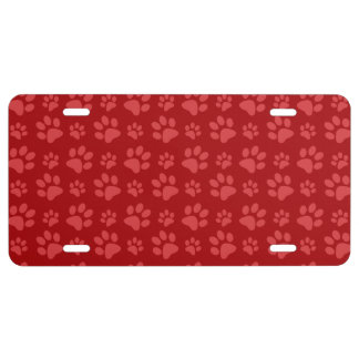 Red dog paw print pattern license plate
