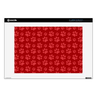 Red dog paw print pattern laptop decal