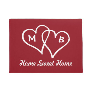 Red door mat with interlocking hearts and initials