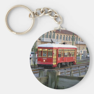 Red electric streetcar on tracks key chains