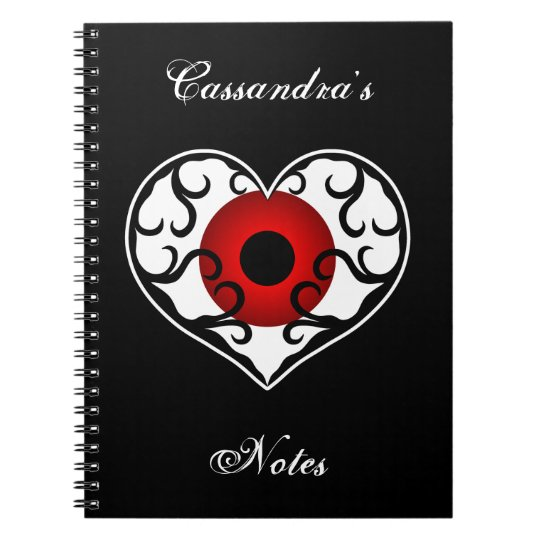 Red eyeball in heart on black spiral notebook