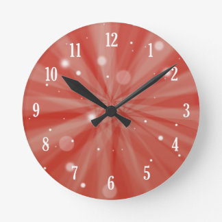 Red festive starburst and snow round clock
